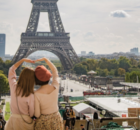Two women looking at Eiffel Tower