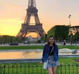 Student in front of Eiffel Tower at sunset