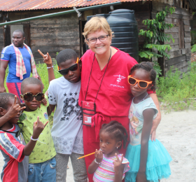 Program leader, Chris Schrage, with children in Suriname