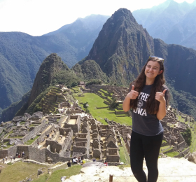 Student standing with Machu Picchu in background