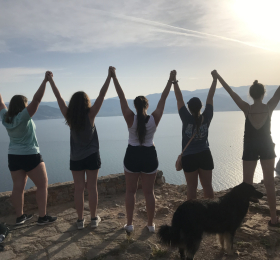 UNI students standing at look out point over the sea