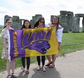 UNI Students in front of Stonehenge