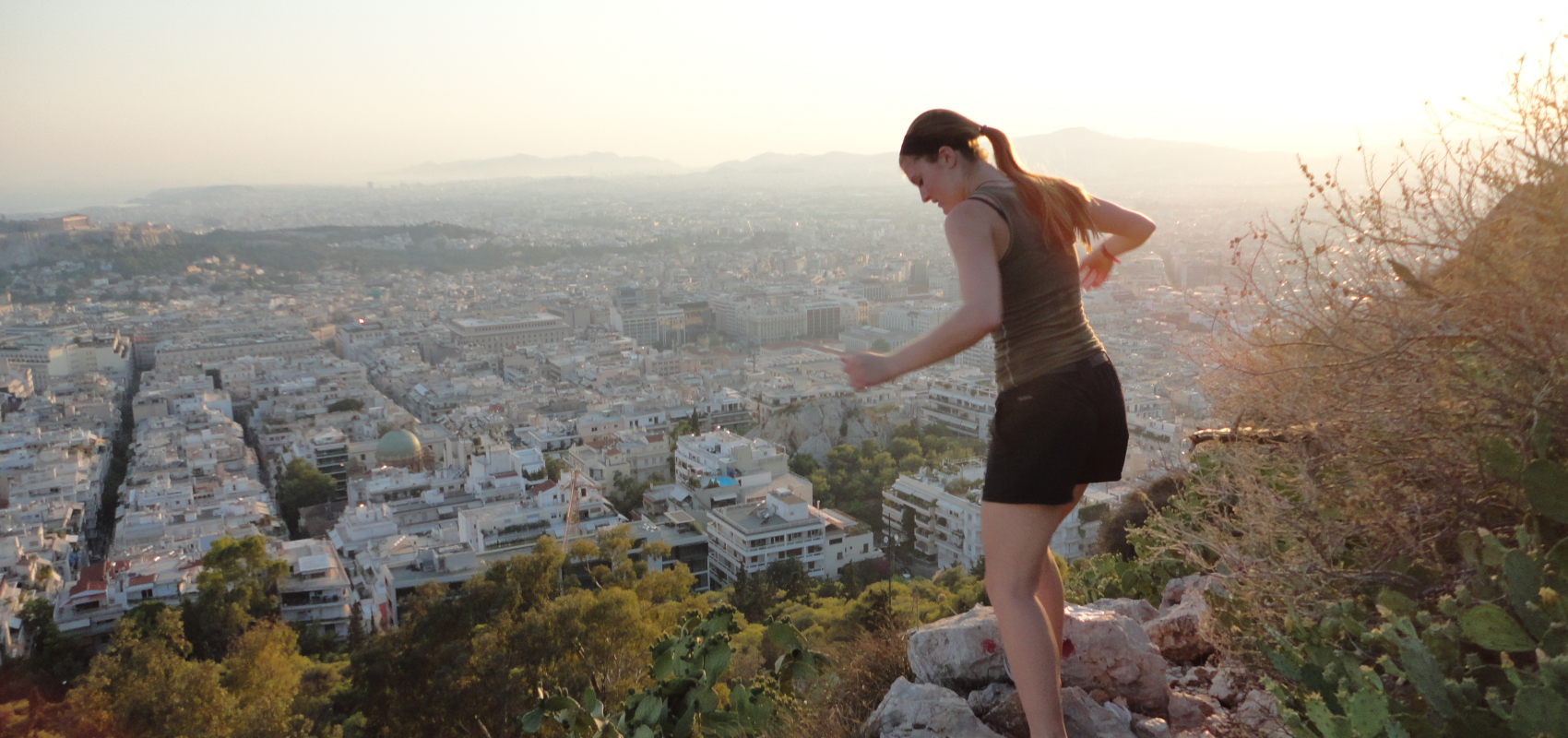 Girl hiking in Greece in the morning