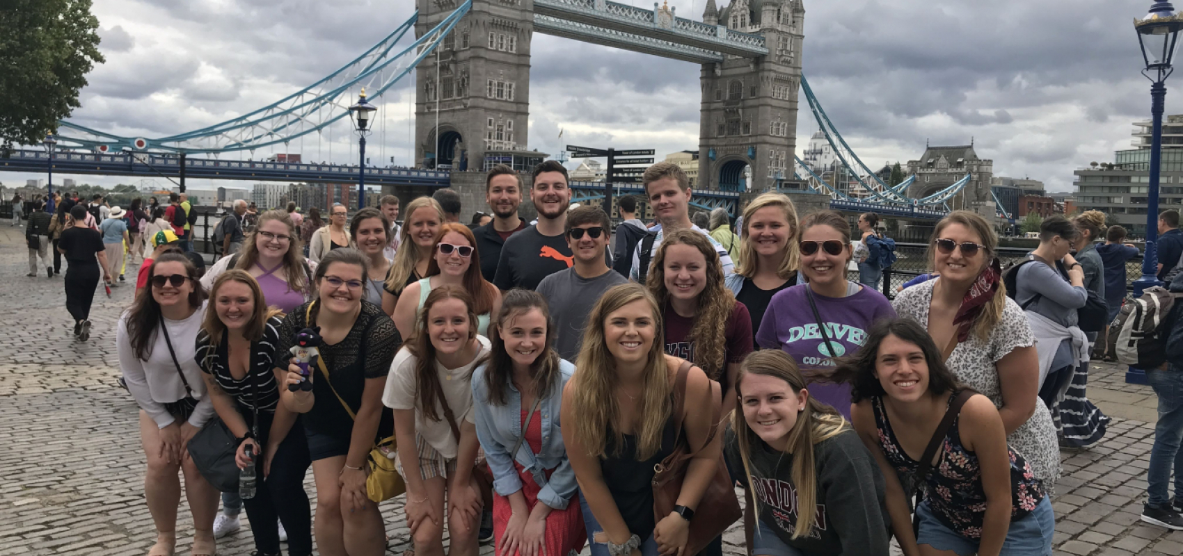 Group photo of summer 2019 students with tower bridge in background