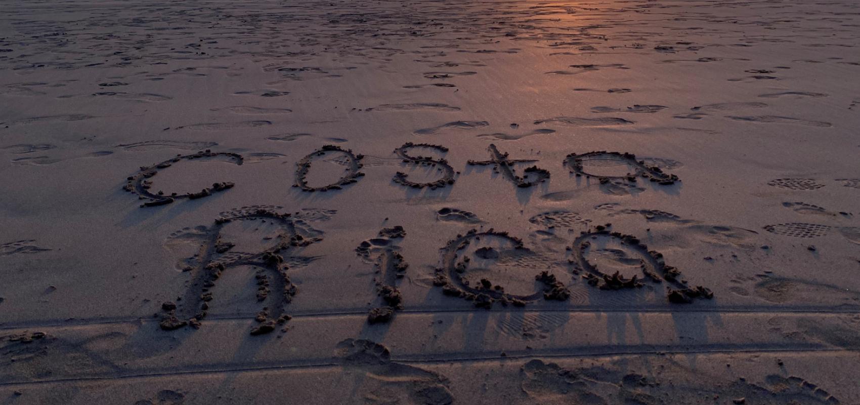 Costa Rica written in the sand