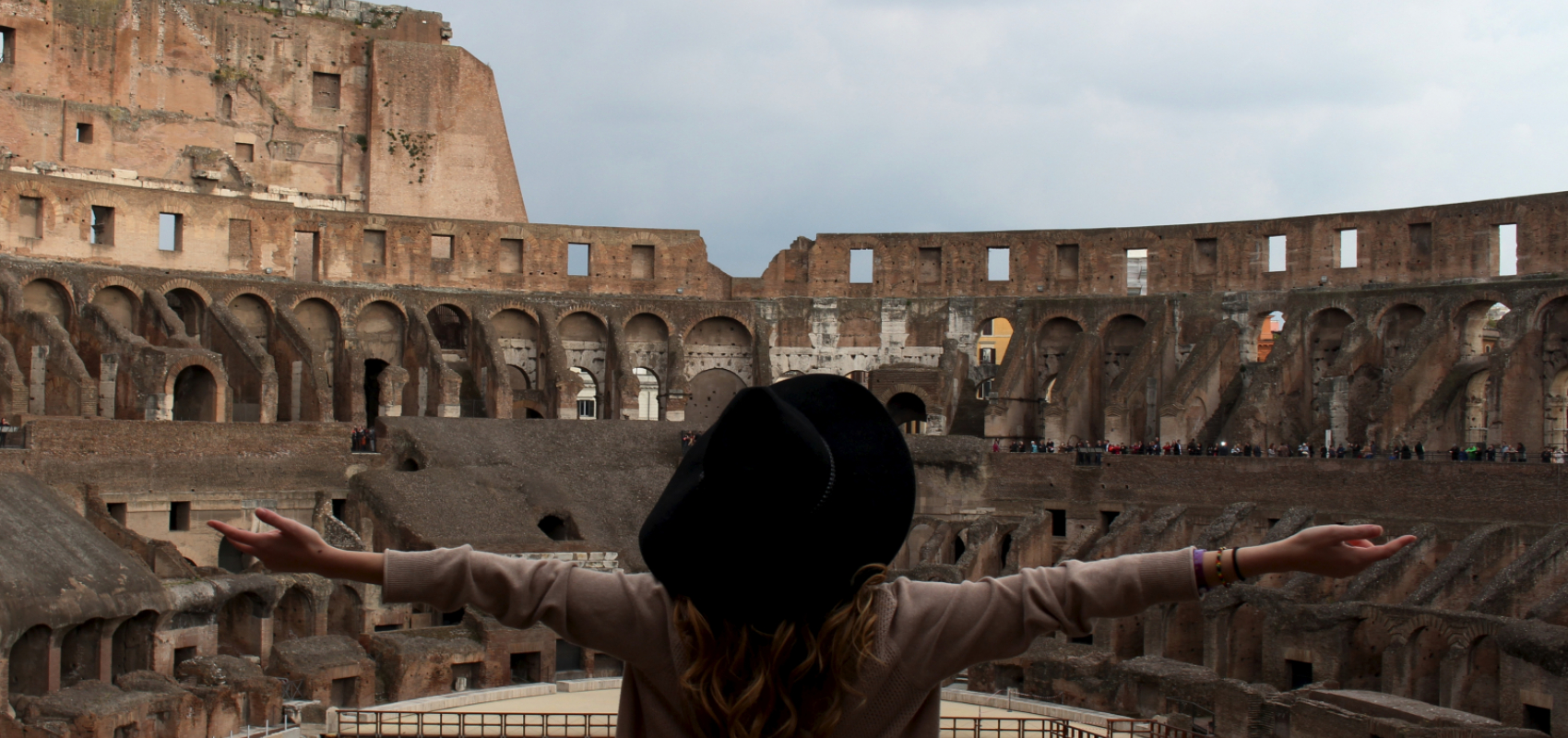 Student in Rome arms outstretched