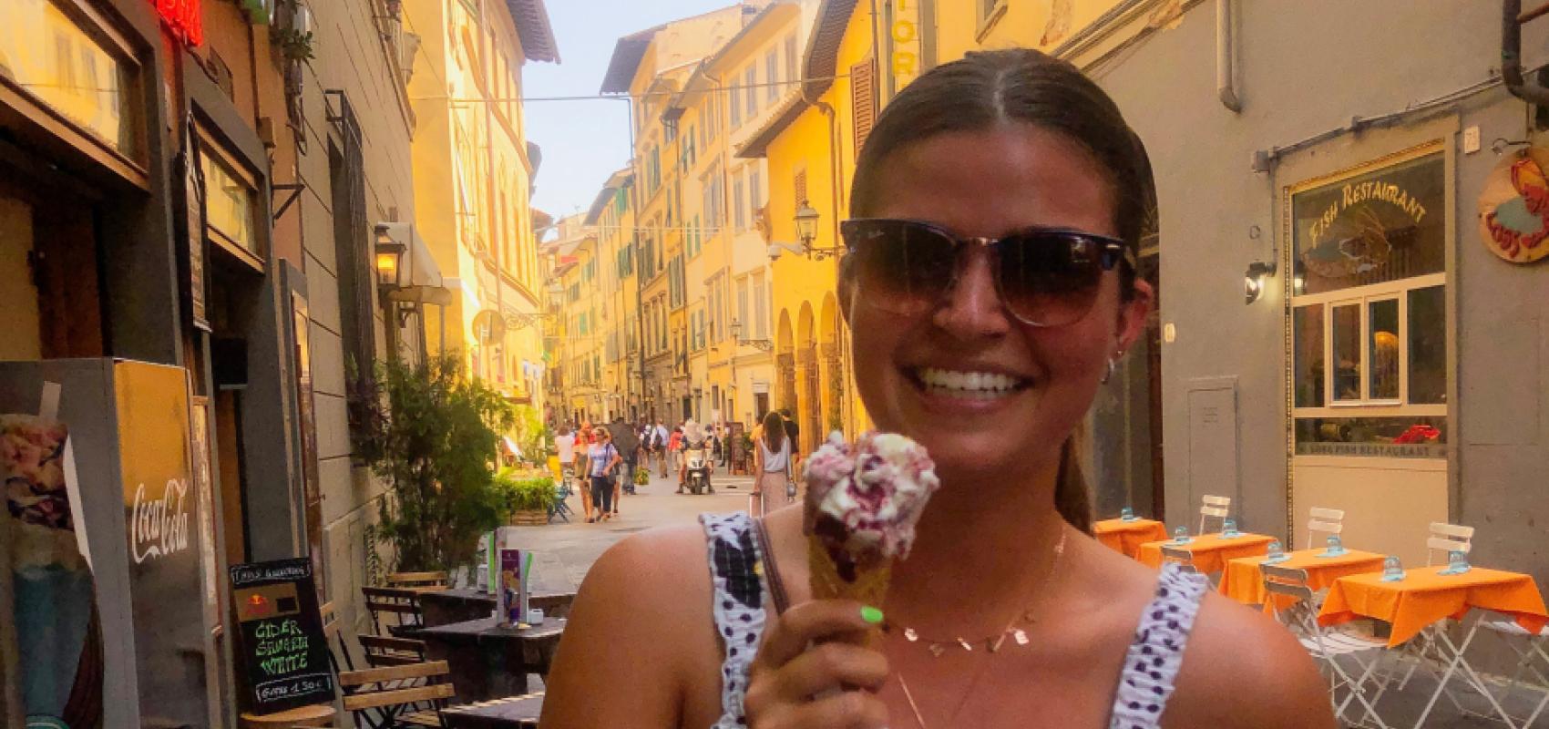 Student enjoying gelato in Italian street