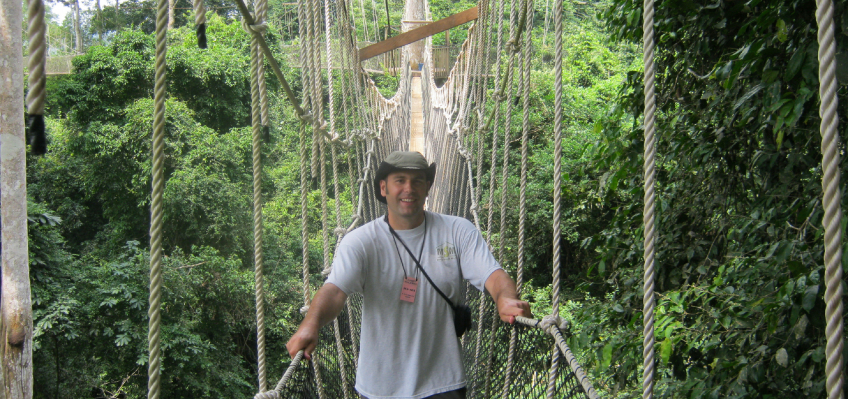 Dr. Frost on forest canopy rope bridge