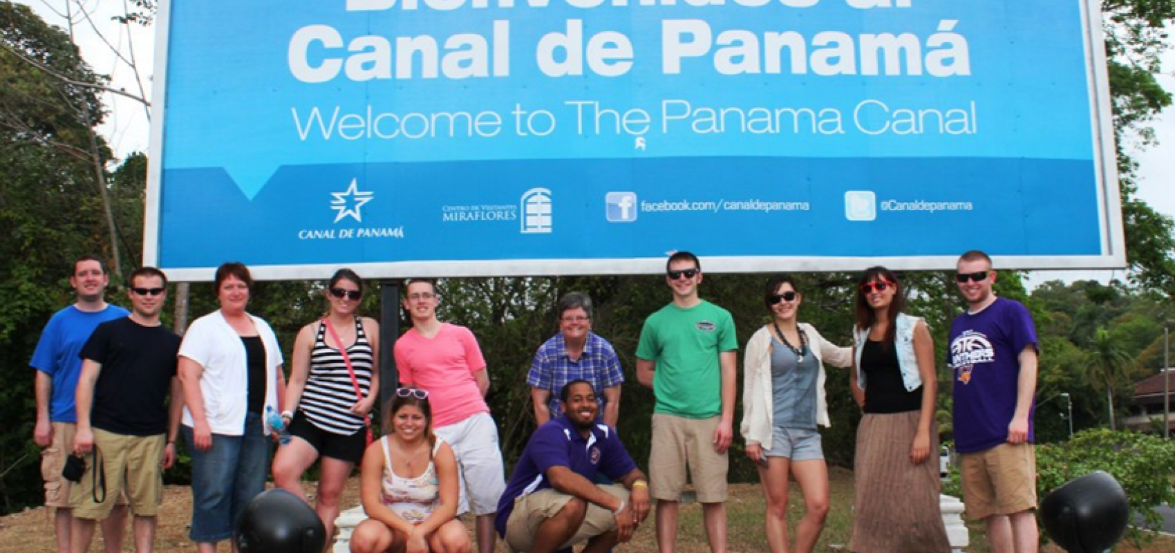 Group of UNI students in front of a Panama Canal sign