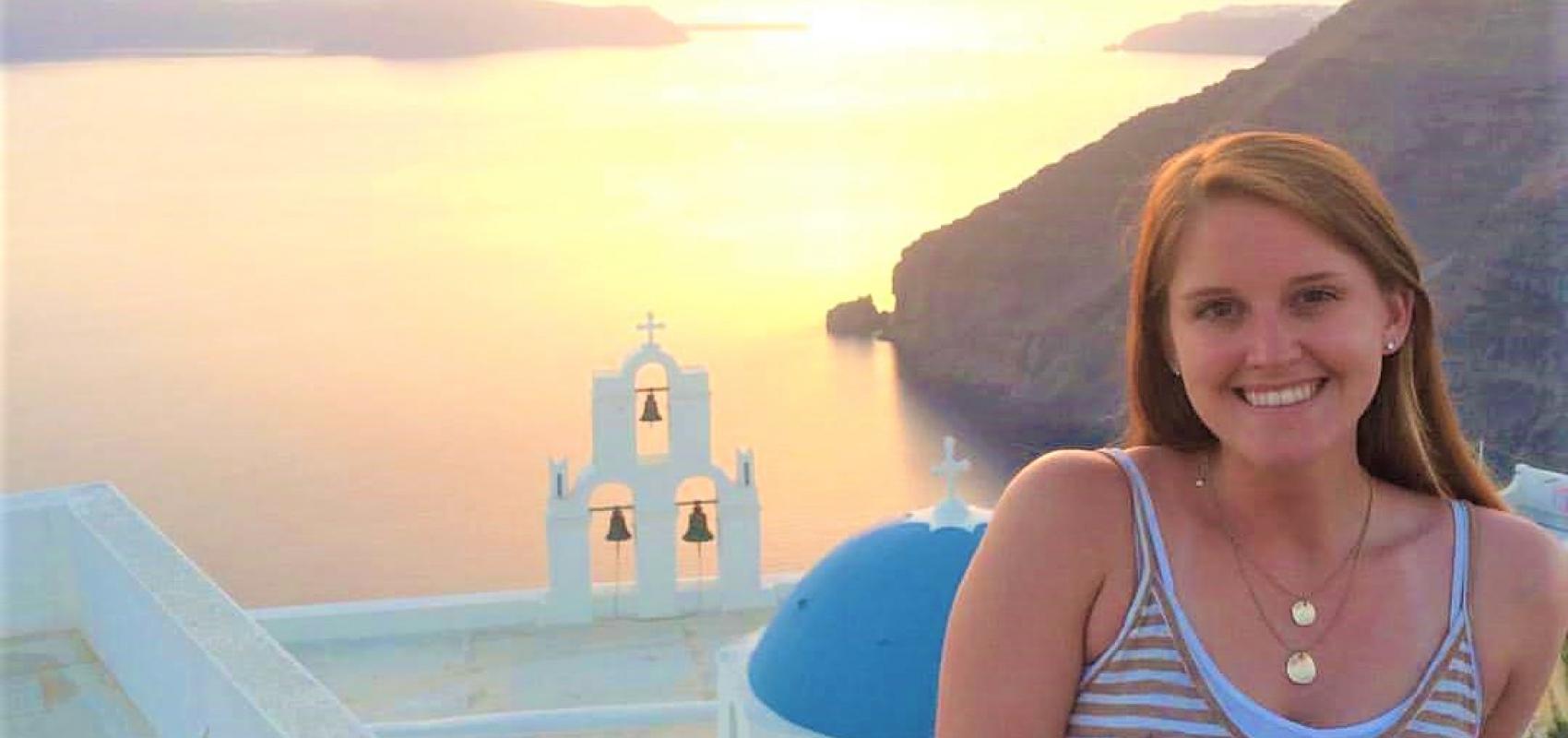UNI student on island of Santorini at sunset overlooking the sea