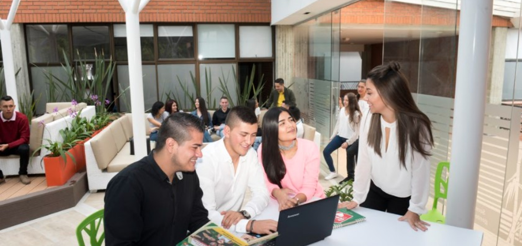Students in Colombia gather around a table